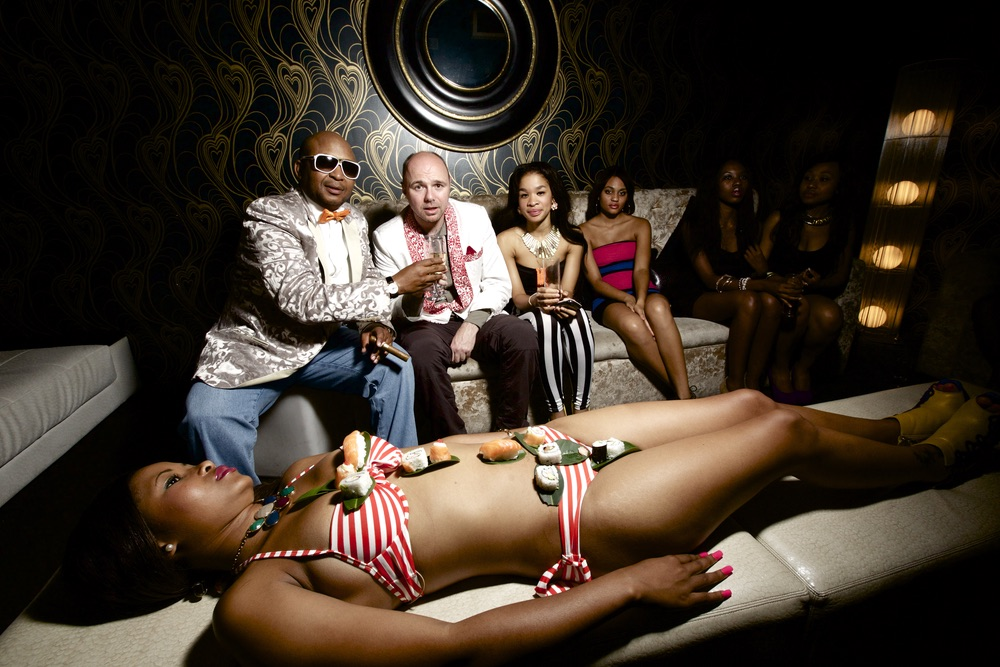 Karl with Kenny Kunene and a sushi girl at one of Kenny's nightclubs