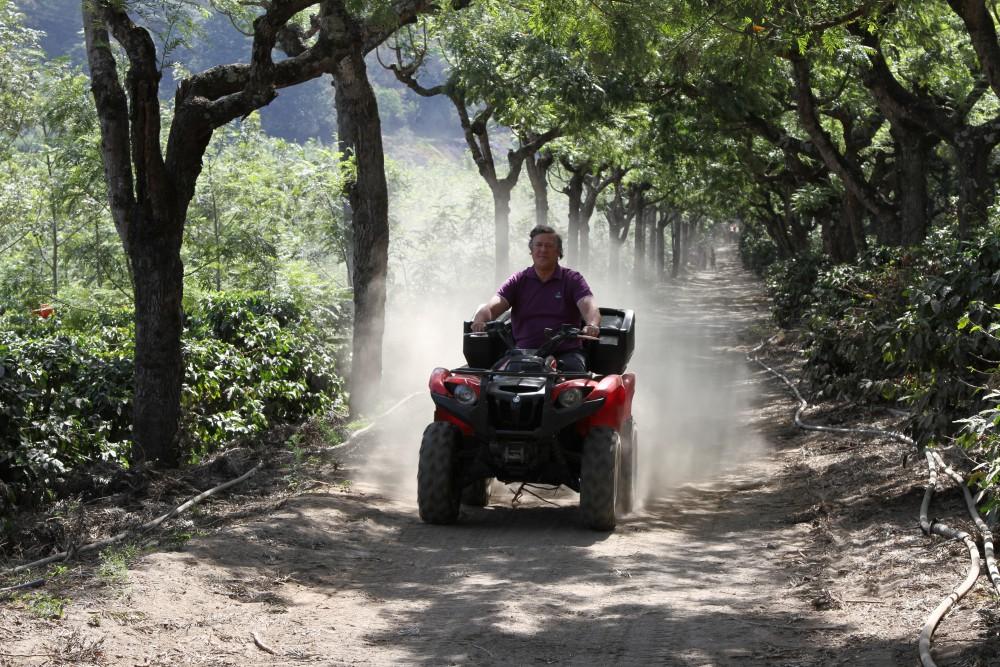 Episode 2_Belize to Guatemala Picture Shows: Stephen riding on 4 wheeler at coffee plantation, Antigua, Guatemala