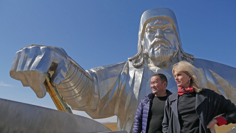 Episode Two - Joanna Lumley and businessman Mr Battulga by a metal statue of Genghis Khan, which he commissioned to be made