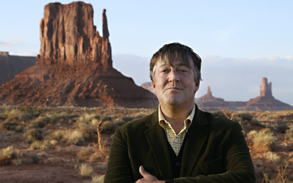 Picture shows: Stephen Fry in Monument Valley; Navajo Tribal Park; Utah - USA GENERIC; TX: BBC One Sunday 12th October at 9.00pm; ©WESTPARK PICTURES; WARNING: Use of this copyright image is subject to the terms of use of BBC Pictures' BBC Digital Picture Service.; In particular; this image may only be published in print for editorial use during the publicity period (the weeks immediately leading up to and including the transmission week of the relevant programme or event and three review weeks following) for the purpose of publicising the programme; person or service pictured and provided the BBC and the copyright holder in the caption are credited.; Any use of this image on the internet and other online communication services will require a separate prior agreement with BBC Pictures.; For any other purpose whatsoever; including advertising and commercial prior written approval from the copyright holder will be required.